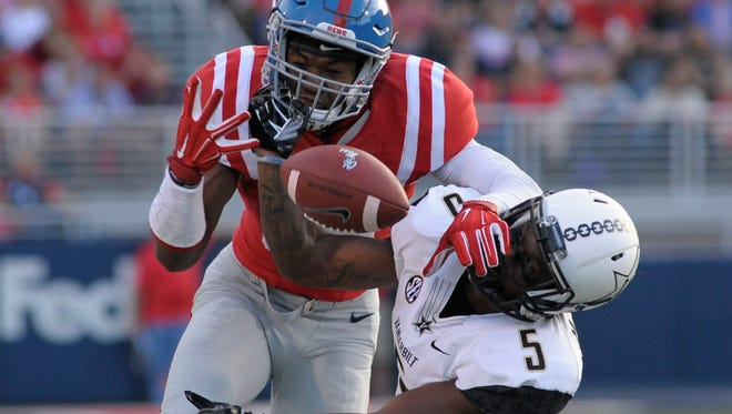 Ole Miss wide receiver Cody Core (88) tries to catch a pass but it's broken up by cornerback Torren McGaster (5) on Sept. 26, 2015.