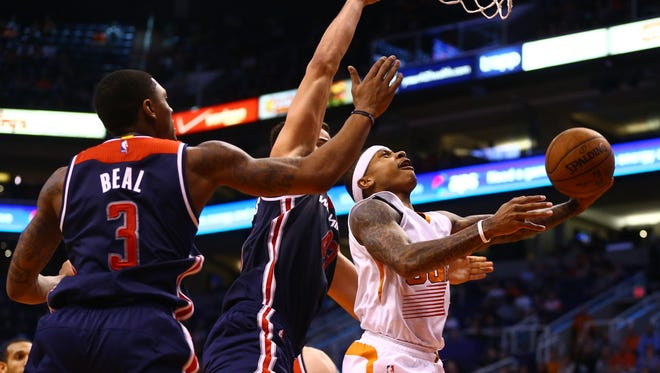 Jan 28, 2015: Phoenix Suns guard Isaiah Thomas drives to the basket in the second half against the Washington Wizards at US Airways Center. The Suns defeated the Wizards 106-98.