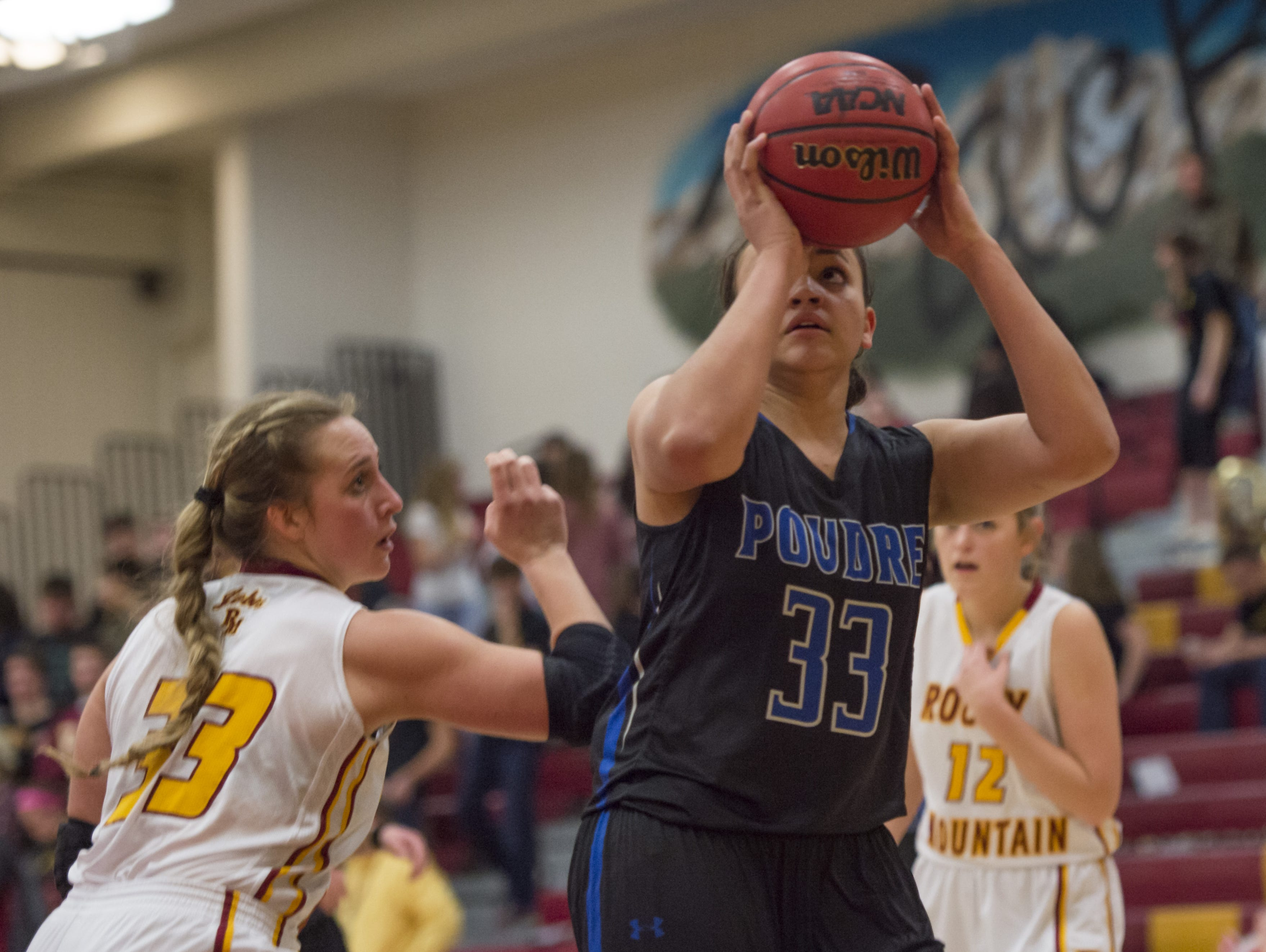 Poudre's Madison Hamm (33), shown earlier this season, scored a game-high 13 points to lead the Impalas to a 45-29 win over Liberty on Saturday to advance to the 5A Sweet 16.
