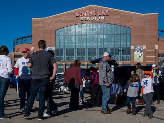 Memorial Tiger fans tailgate before the Class 3A State Championship against the Brebeuf Jesuit Braves at Lucas Oil Stadium in Indianapolis, Ind., Friday, Nov. 24, 2017.