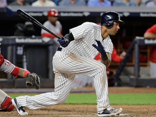 Aaron Hicks follows through on an RBI single during the sixth inning of the team's baseball game against the Los Angeles Angels on Wednesday, June 21, 2017, in New York.