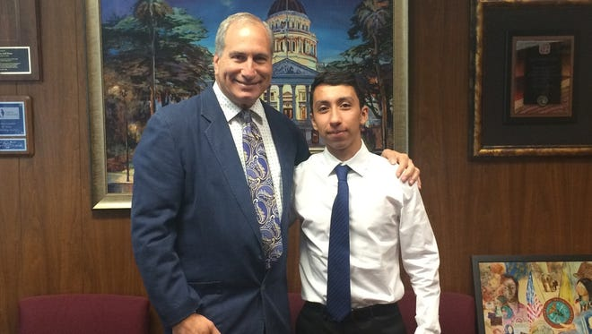 Republican state Sen. Jeff Stone of Temecula with Robert Ortega, a Shadow Hills High School senior whose financial literacy bill passed the Senate on May 31, 2017.