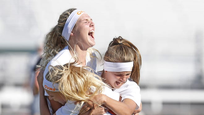 Chino Valley's Lauren Foster, #3, Felicity Stickrod, #9, and Ashley McGuffy, #16, celebrate after winning the 2A Conference girls soccer state championship game against Round Valley at Camp Verde High School in Gilbert on November 5, 2016.