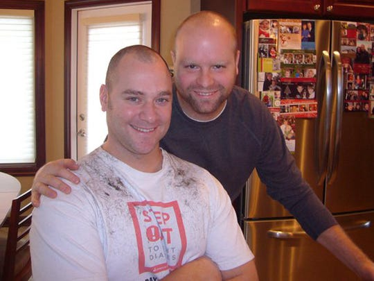 Chad Baker shaved his head prior to chemo so he wouldn't have to endure a patchy hair loss. His cousin Tim Boersma of Grand Rapids, Mich., manned the clippers.