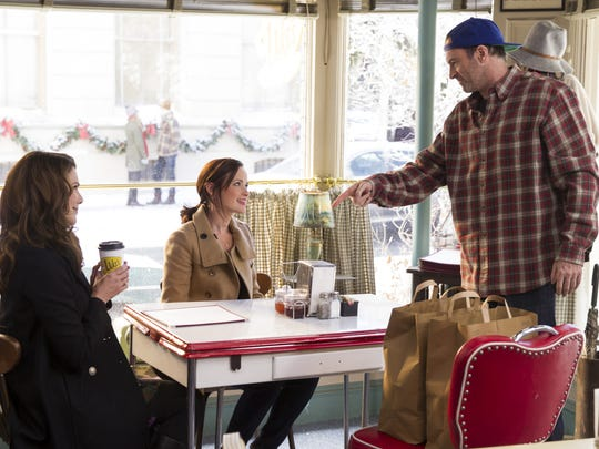 "From left, Lauren Graham, Alexis Bledel and Scott Patterson act in a scene from ""Gilmore Girls: A Year in the Life."""