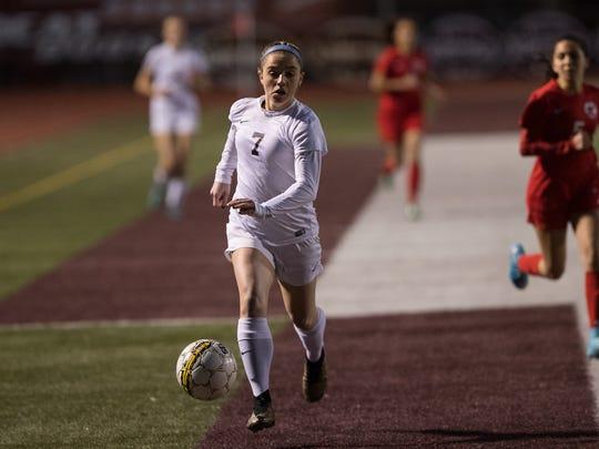 Calallen's Dana Curtis drives the ball up the field