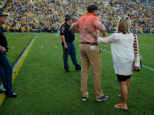 Auburn head coach Gus Malzahn is consoled by Kristi Malzahn after the NCAA football game between Auburn and LSU on Saturday, Oct. 14, 2017, at Tiger Stadium in Baton Rouge, La. LSU defeated Auburn 27-23.