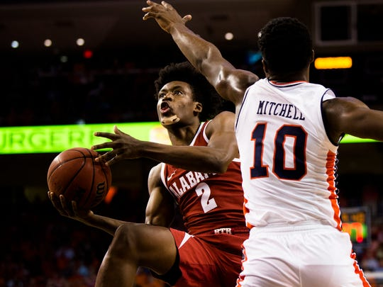 Alabama Crimson Tide guard Collin Sexton (2) shoots around Auburn Tigers guard Davion Mitchell (10) during the NCAA basketball game on Wednesday, Feb. 21, 2018, in Auburn, Ala.