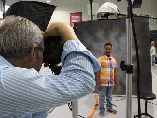 A Reagan Elementary fifth-grader has his photo taken