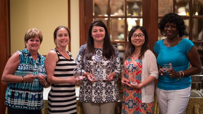 Left to Right: Kathy McNally, Nikolina Novakovic, Danielle Benson, Tami Xue and  Denise Gaines pictured in 2016 with their customer service awards.