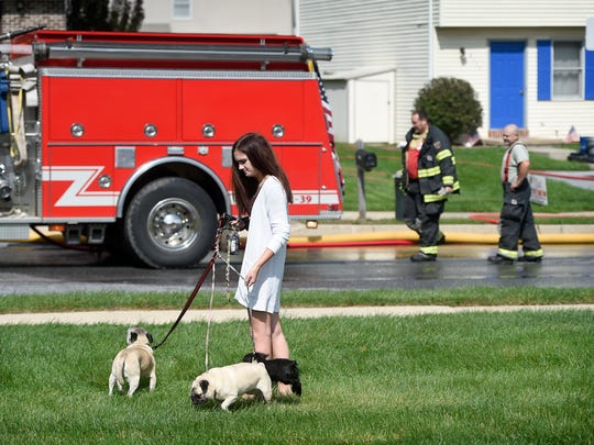 """""""I don't know how long it's going to be,"""" said Sarah Grant after being evacuated with her three dogs. """"They just knocked on my door and told me I had to leave."""" Approximately 80 residents were evacuated."""