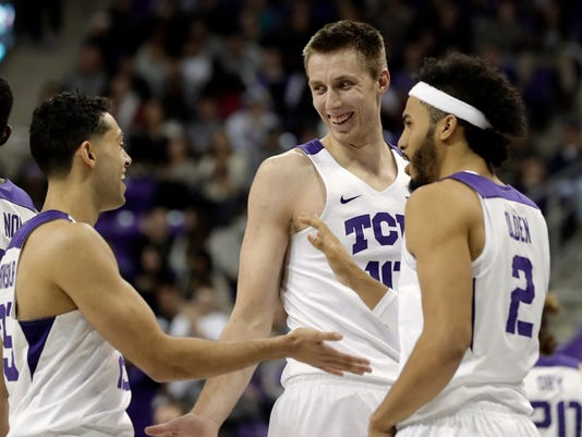 TCU's Alex Robinson, left, Vladimir Brodziansky (10) of Slovakia and Shawn Olden (2) celebrate in the closing seconds of an NCAA college basketball game against Iowa State on Wednesday, Jan. 17, 2018, in Fort Worth, Texas. TCU won 96-73. (AP Photo/Tony Gutierrez)