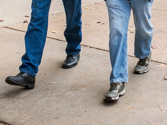 Members of the Asheville Amblers walking group step out in downtown Asheville in this file photo.