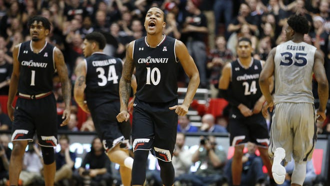 Cincinnati Bearcats guard Troy Caupain (10) encourages the team in the second half.