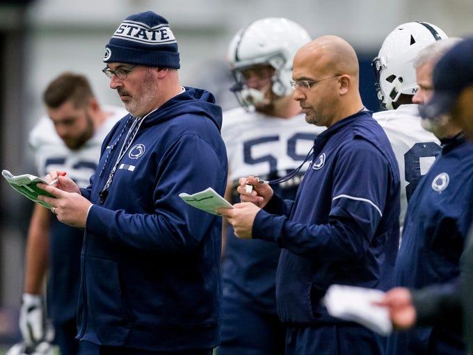 Penn State offensive coordinator Joe Moorhead, front
