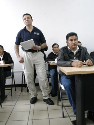 Chicago police officer Dante Servin listens to a presentation by Mexican cadets during an investigative methods class he is co-teaching with Mexican and Colombian instructors at a Mexican Federal Police Academy in San Luis Potosi, Mexico on Oct. 27, 2009.