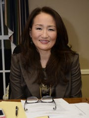 Harrington Borough Council member Joon Chung  speaks