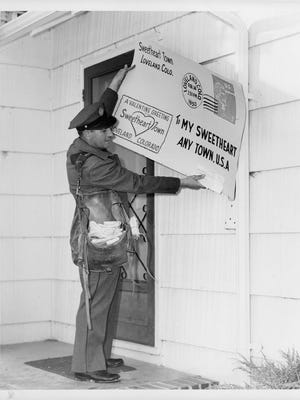 Mail carrier Taylor Hausman poses for a shot in 1962.
