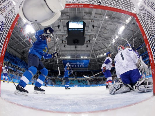 Joonas Kemppainen (23), of Finland, and his teammates celebrate after Petri Kontiola (27) scores a goal against South Korea during the first period of the qualification round of the men's hockey game at the 2018 Winter Olympics in Gangneung, South Korea, Tuesday, Feb. 20, 2018. (AP Photo/Julio Cortez, Pool)