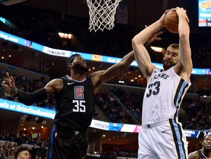 Memphis Grizzlies center Marc Gasol (33) grabs a rebound