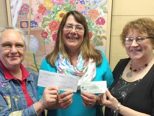 "Pictured, (left to right), are From left, Roberta Thelen, a member of St. Luke's Outreach Ministries; Janet Lee, president of ""Secret Santa""; and Trudy Jischke, a member of St. Luke's Outreach Ministries, with the donation to the Secret Santa program"