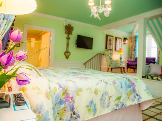 Bright colors, floral linens and cabana stripes create a whimsical, on-vacation atmosphere in the Grand's guest rooms