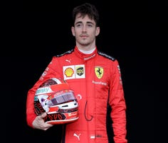Ferrari driver Charles Leclerc of Monaco poses for a photo at the Australian Formula One Grand Prix in Melbourne, Thursday, March 12, 2020. (AP Photo/Rick Rycroft)