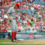 Cincinnati Reds starting pitcher John Lamb (47) reacts after walking the bases loaded against the Washington Nationals during the fourth inning at Nationals Park.