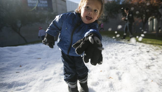 Ibai Challoner, 3, throws snow into the camera at the Arizona Science Center in Phoenix on Dec. 26 2016.