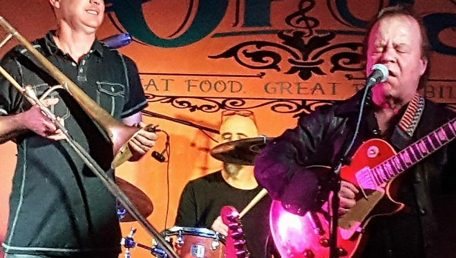 The Blue Opus owner Bill Hill, left, performs with blues musician Jimmy Crimmins at the Bellevue music venue and restaurant. The business announced Tuesday it has permanently closed.