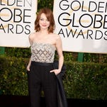 'Birdman' star Emma Stone ruled the fashion roost at Sunday's Golden Globes.<br /> <br /> Her Lanvin jumpsuit with a train flew right to the top of many best-dressed lists.<br /> <br /> Click ahead to see our picks for the nine other ladies who made a fashion impact.