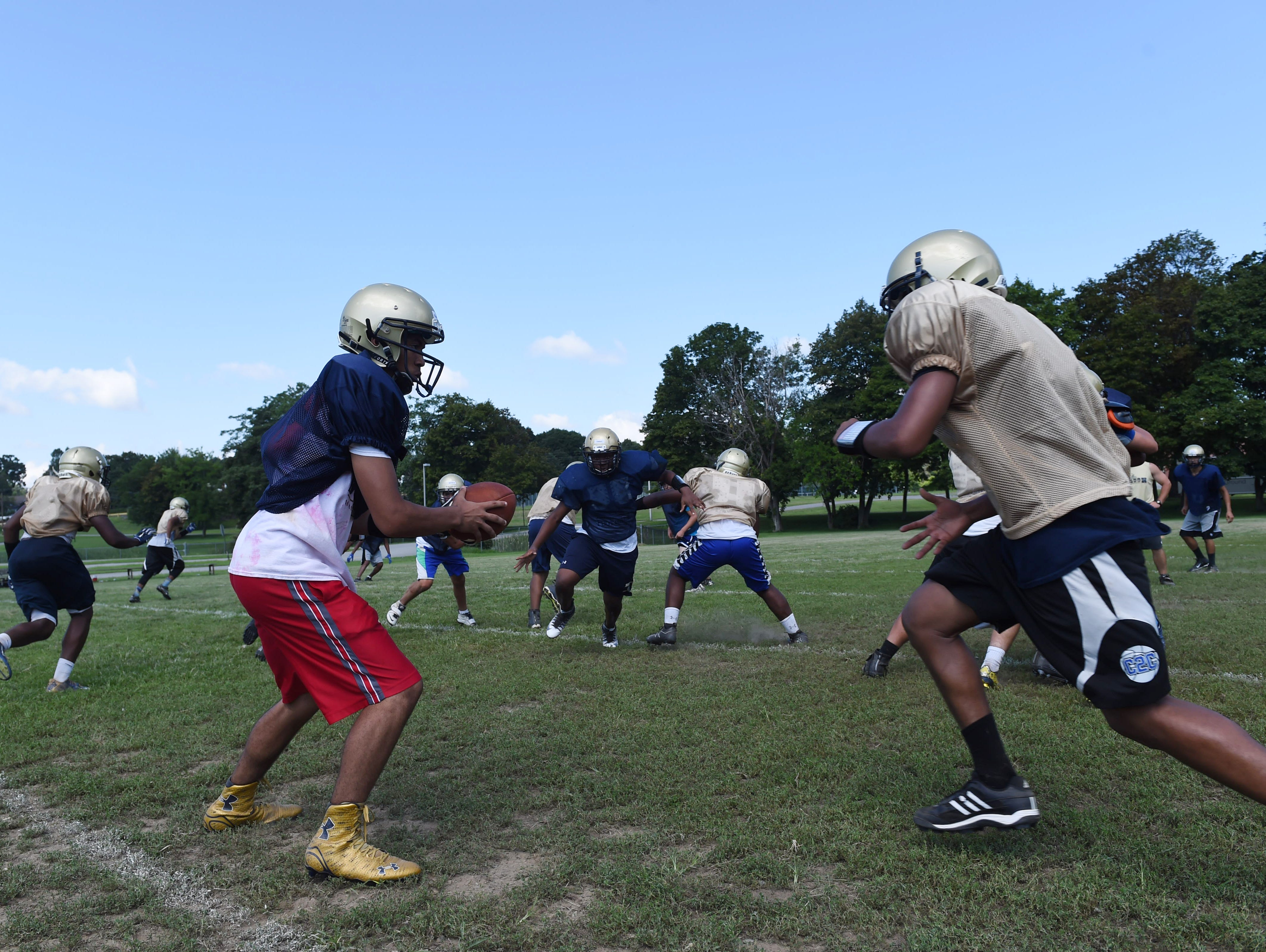 Beacon High School's from left, Jaden Navarro hands off the ball to Jerome Henderson during Friday's preseason practice at Rombout Middle School.