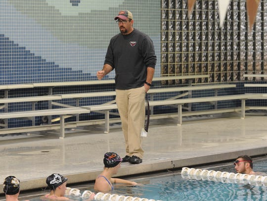McMurry swim coach Casey Pacheco talks to his team