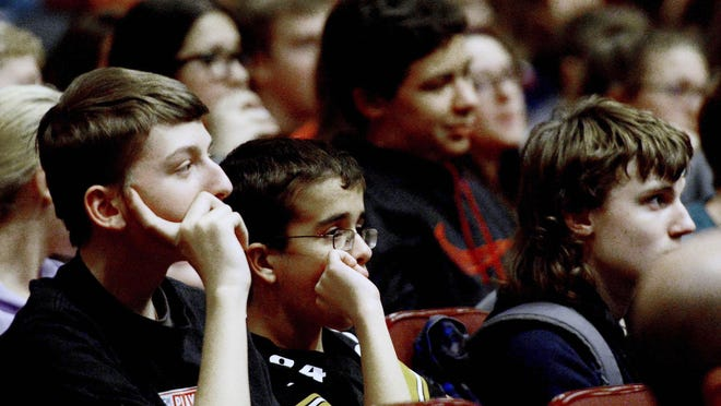 Levi Baer, 14, left, and Matthew Sander, 14, listen to a presentation by Socialize Right about online etiquette and managing social media profiles at Springdale Junior-Senior High School in Springdale, Pa.