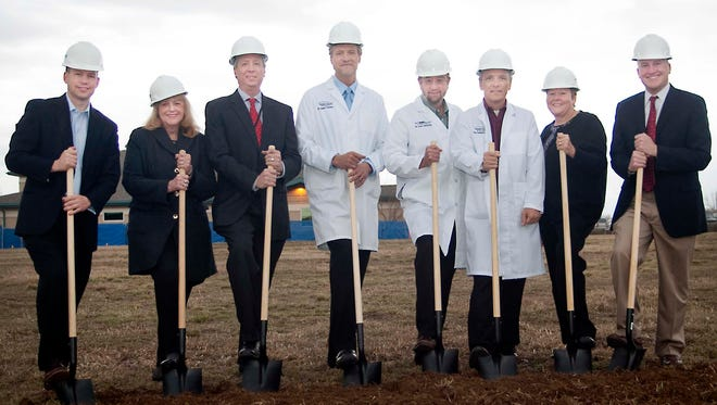 University of Colorado Health has officially broken ground on a new emergency center in southeast Fort Collins. Several UCHealth officials were on hand at a recent ceremonial groundbreaking at the site of the future UCHealth ER: from left, Russ Woolley, vice president of support services; Donna Poduska, Poudre Valley Hospital chief nursing officer; Rodney Good, senior director of pharmacy services; Dr. Jamie Teumer, vice chief of staff at Medical Center of the Rockies; Dr. Scott Johnston, medical director of emergency services; Dr. Jim Campain, medical director at UCHealth ER in Fort Collins; Janice Mierzwa, senior director of emergency services; and Kevin Unger, chief executive officer and president of PVH and MCR. (Photo courtesy of University of Colorado Health)