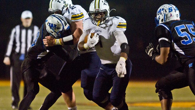 Toms River North's Asante Moorer gains yardage.Toms River North defeats Williamstown for the NJSIAA Group V State Championship title. Glassboro, NJSaturday, December 5, 2015@dhoodhood
