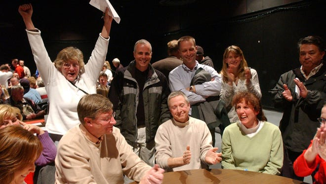 Enid Schenk, back left, raises her hands in victory after Gov. Mitt Romney won the Precint 436 caucus at Rocky Mountain High in Fort Collins on Tuesday, Feb. 5, 2008.