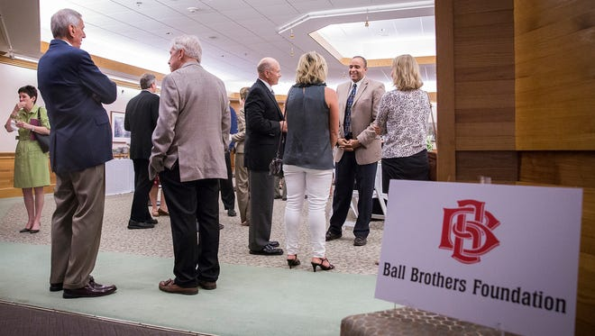 Attendees have dinner and drinks before a short award ceremony during the Ball Brothers Spring Reception at Minnetrista Wednesday evening.