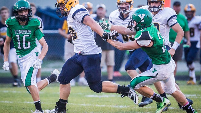Delta's Charlie Spegal powers past Yorktown's defense during their game at Yorktown High School Friday, Sept. 9, 2016.