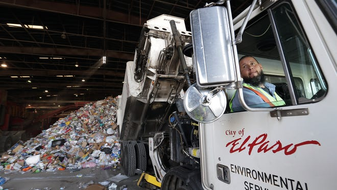 A driver for El Paso Environmental Services dumps a recycling load at the Friedman Recycling Plant in Northeast El Paso where it will be sorted and eventually recycled.