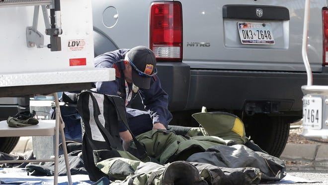 El Paso Police Department Bomb Squad members prepare their gear during a bomb scare in February at the Social Security Administration offices in Downtown El Paso.