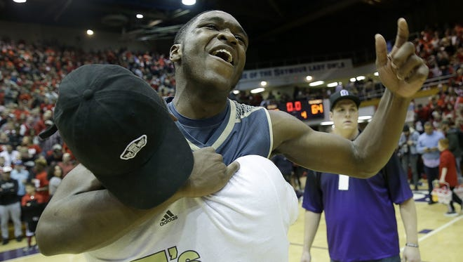 Senior guard Dean Tate, who led Warren Central with 21 points, celebrated  the victory Saturday over New Albany. The Warriors will play Carmel  in the 4A state championship March 24 at Bankers Life.
