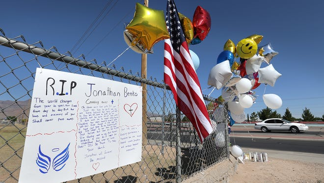A memorial was erected where Parkland Middle School sixth-grader Jonathan Benko jumped the fence before he was killed by a passing truck Friday. He left a National School Walkout gathering at the school with other students.