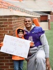 Savana Jones, 8, smiles for a photo with then-quarterback