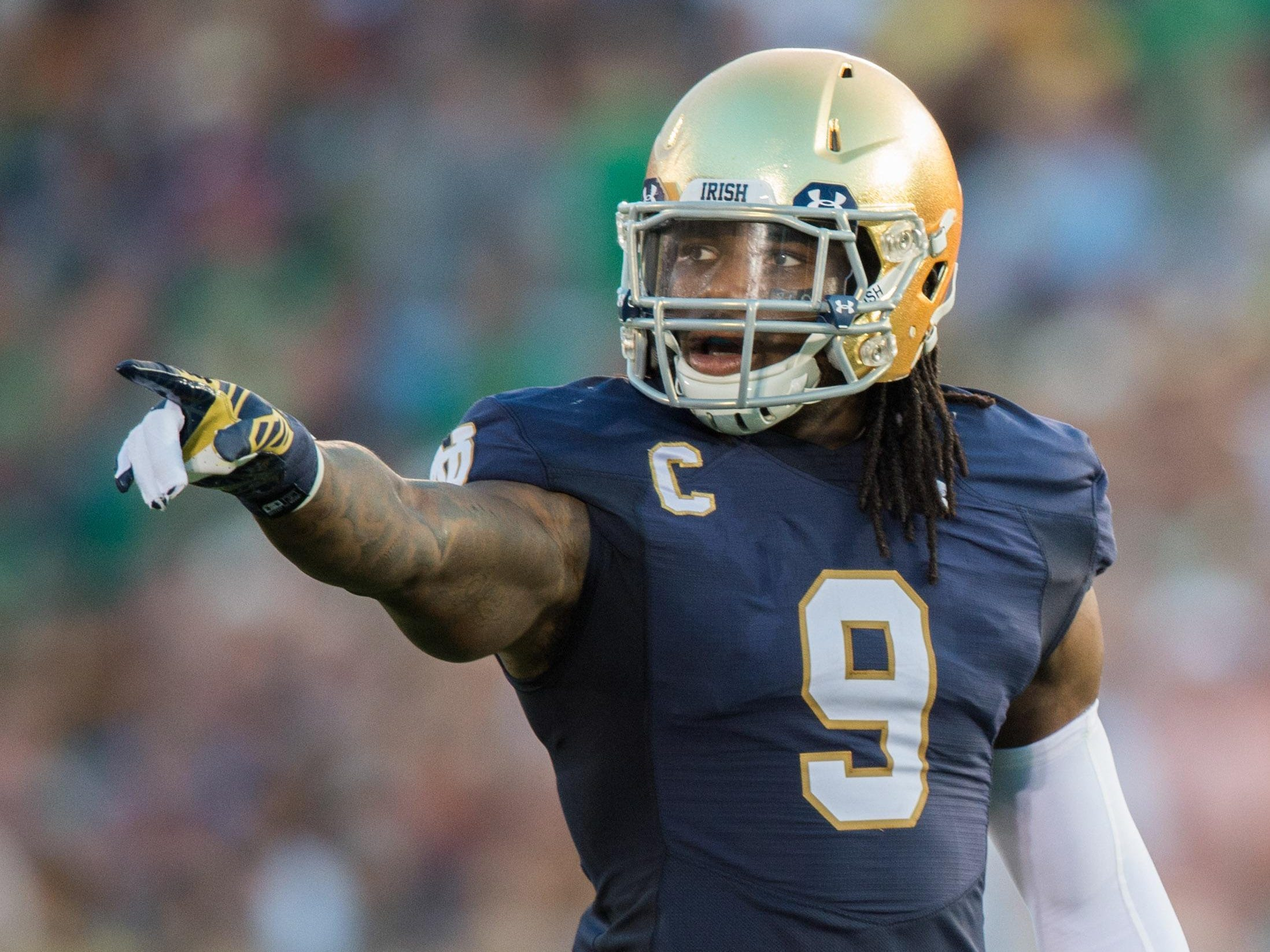 Sep 5, 2015; South Bend, IN, USA; Notre Dame Fighting Irish linebacker Jaylon Smith (9) signals in the first quarter against the Texas Longhorns at Notre Dame Stadium. Notre Dame won 38-3. Mandatory Credit: Matt Cashore-USA TODAY Sports