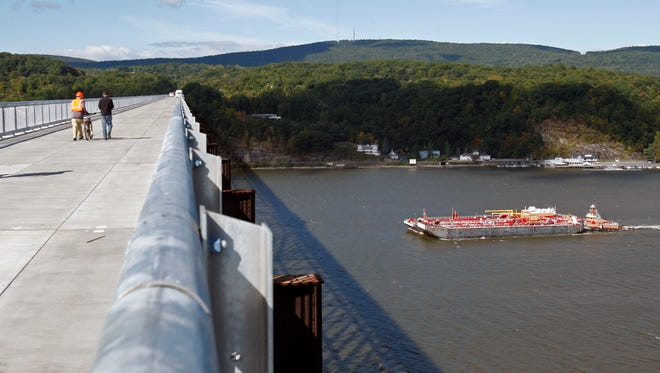 """A barge cruises under the Walkway Over the Hudson in Poughkeepsie. The former railroad bridge was featured in the PBS film """"Rails-to-Trails,"""" which premiered May 18."""