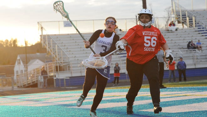 Chillicothe's Olivia Eblin fights with Westerville South's goalie for possession of the ball during Thursday night's contest at Herrnstein Field. The Cavaliers earned a 14-2 win, their first this season.