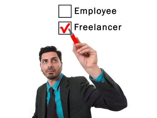 businessman choosing freelancer to employee option ticking box with marker