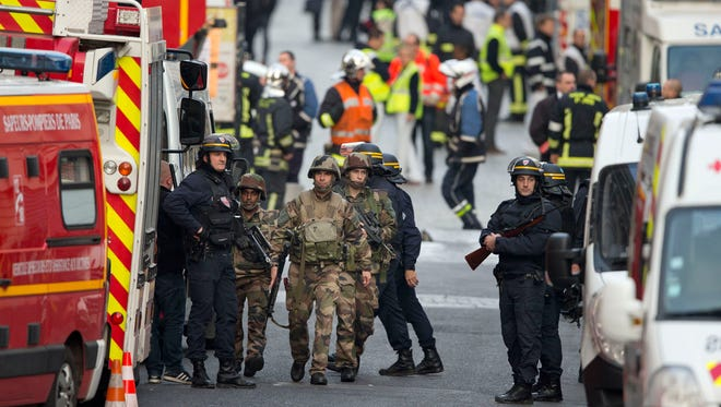 French soldiers and police work during a police raid in Saint-Denis on Nov. 18, 2015.