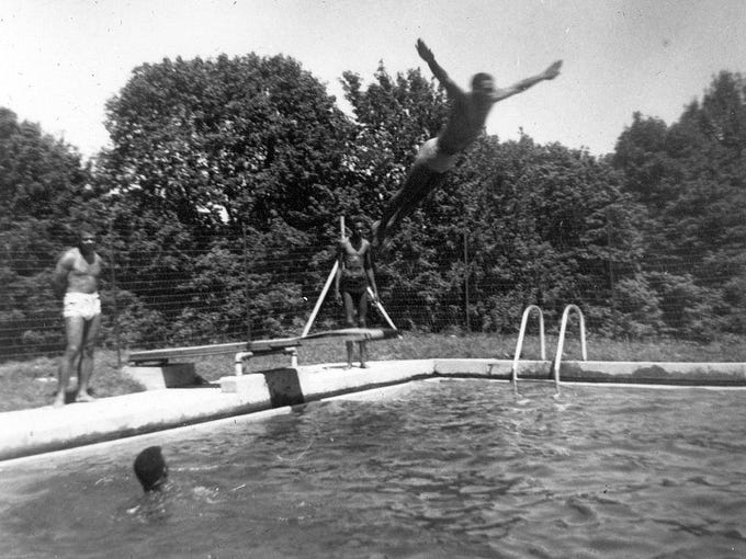 Buster Bowles prepares to dive into the pool at Montgomery
